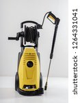 yellow high pressure washer on... | Shutterstock . vector #1264331041