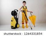 happy child in yellow overalls... | Shutterstock . vector #1264331854