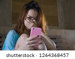 young depressed asian korean... | Shutterstock . vector #1264368457