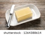 dish with fresh butter and... | Shutterstock . vector #1264388614