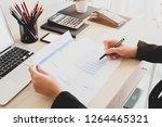 business women writing on... | Shutterstock . vector #1264465321