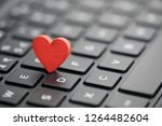 small red heart on keyboard.... | Shutterstock . vector #1264482604