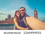 tourist couple travelling in... | Shutterstock . vector #1264494931