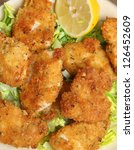 Italian chicken fillets fried in breadcrumbs, herbs and grated Parmesan cheese. - stock photo