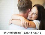 a young woman embraces a guy by ... | Shutterstock . vector #1264573141