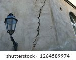 earthquake damage. cracked wall ... | Shutterstock . vector #1264589974