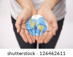 a pair of young hands hold... | Shutterstock . vector #126462611