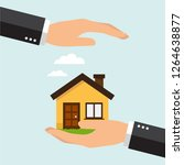 two hands protect a home ... | Shutterstock .eps vector #1264638877