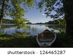morning light on a canoe on the ... | Shutterstock . vector #126465287