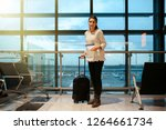 woman smiling waiting her... | Shutterstock . vector #1264661734