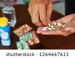 elderly asian man holding many... | Shutterstock . vector #1264667611