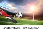 soccer player kicks the ball on ...   Shutterstock . vector #1264680064