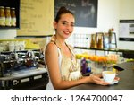 a quick cup to start a hectic... | Shutterstock . vector #1264700047