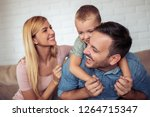 young parents having fun with... | Shutterstock . vector #1264715347