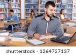 focused positive friendly guy... | Shutterstock . vector #1264727137