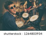 male drummer looking up with... | Shutterstock . vector #1264803934