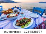 Small photo of Traditional Cretan Dorada fish with Greek salad, Kissamos, Crete, Greek Islands, Greece, Europe
