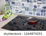 electric stove. frying pan is... | Shutterstock . vector #1264874251