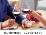 young man and woman on date in... | Shutterstock . vector #1264876594