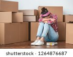young woman moving to new place ... | Shutterstock . vector #1264876687