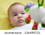 baby looking up at a mobile toy | Shutterstock . vector #126490721