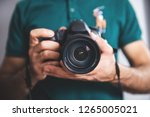 man hand holding photo camera | Shutterstock . vector #1265005021