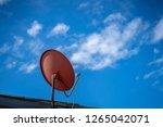 satellite tv antenna on blue... | Shutterstock . vector #1265042071