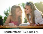 two happy women reading menu in ... | Shutterstock . vector #126506171