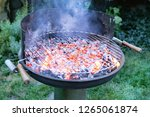 flaming grill with open fire ... | Shutterstock . vector #1265061874