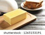wooden board with fresh butter... | Shutterstock . vector #1265153191