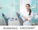 young female dentist in white... | Shutterstock . vector #1265156407