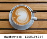 hot italian cappuccino coffee... | Shutterstock . vector #1265196364