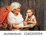 grandmother and granddaughter... | Shutterstock . vector #1265243554