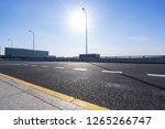 empty asphalt road with city... | Shutterstock . vector #1265266747