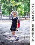 cute little schoolgirl with...   Shutterstock . vector #1265307751