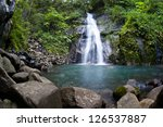 a waterfall cascades into a... | Shutterstock . vector #126537887