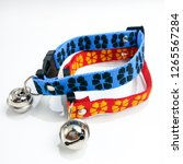 two dog pet cat collar with a... | Shutterstock . vector #1265567284