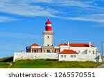 old red lighthouse building at... | Shutterstock . vector #1265570551