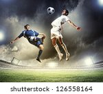 two football players in jump to ... | Shutterstock . vector #126558164