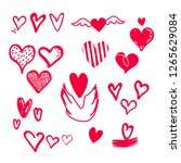 hand drawn hearts on isolated... | Shutterstock .eps vector #1265629084