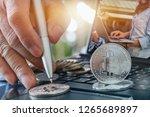 double exposure golden bitcoin... | Shutterstock . vector #1265689897