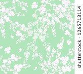 seamless pattern of flowering... | Shutterstock . vector #1265713114