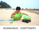 cute little boy play on beach | Shutterstock . vector #1265736691