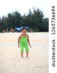 cute little boy play on beach | Shutterstock . vector #1265736694