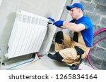 plumber at work. installing... | Shutterstock . vector #1265834164