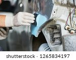 auto repairman plastering... | Shutterstock . vector #1265834197