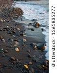 the seashore with stones | Shutterstock . vector #1265835277