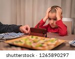 child watching too many content ... | Shutterstock . vector #1265890297