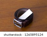 closeup of a rolled brown... | Shutterstock . vector #1265895124