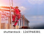 worker go up the stairs to high ... | Shutterstock . vector #1265968381
